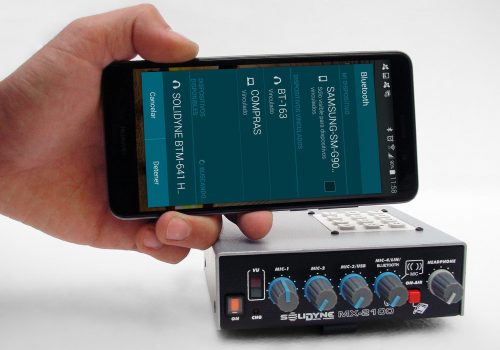 MX2100con-celularymano
